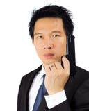 与一杆枪的亚洲男性在白色 免版税库存照片