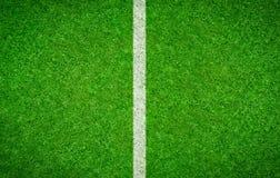 与一条垂直线的橄榄球背景 库存照片