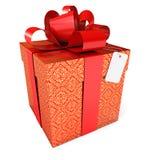 与一条红色丝带和弓的礼品 库存照片