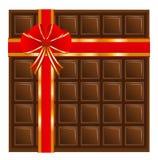 与一条红色丝带的巧克力,设计的背景 免版税库存图片