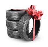 与一条红色丝带的轮胎。礼物。3D象  库存图片