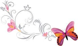 与一根装饰开花的小树枝的明亮的蝴蝶 免版税库存图片