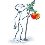 与一棵小的苹果树的棍子形象 免版税库存照片