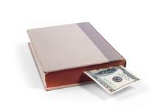 与一百元钞票书签的书 免版税库存图片