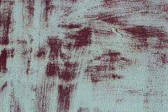 与一种红色破旧的金属的难看的东西背景与白色油漆残余  金属纹理 库存图片