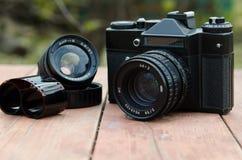 与一部另外的透镜和影片的葡萄酒照相机Zenit 免版税库存图片