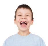 与一颗失去的牙的男孩画象 免版税库存照片