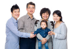 与三一代的愉快的亚洲家庭 库存图片
