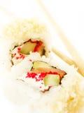 与三文鱼和筷子的二寿司卷 免版税库存照片