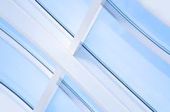 与三角和线的几何蓝色抽象背景 免版税库存照片
