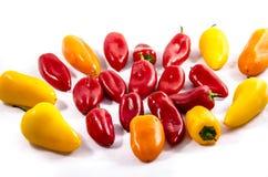 与不同的神色的22个小甜椒 免版税库存照片