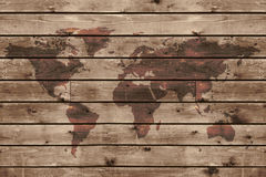 与世界地图的老木纹理 免版税库存照片