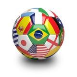 与世界杯队旗子的足球 库存照片