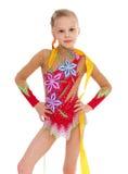 与丝带的可爱的小的体操运动员跳舞 库存图片