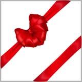 与丝带的红色心形的弓 免版税库存图片