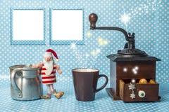 与两个空的照片框架的逗人喜爱的圣诞卡 免版税库存照片