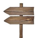 与两个箭头的木方向标在一个方向 免版税库存照片