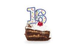 与两个蜡烛的生日蛋糕 免版税库存图片