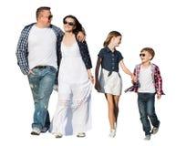 与两儿童走的家庭 免版税库存图片