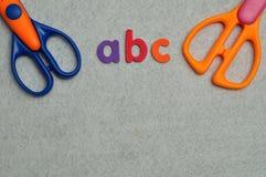 与两把剪刀的ABC 免版税库存图片