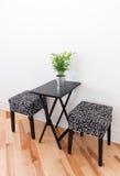 与两把椅子的黑桌 免版税库存图片