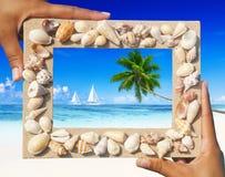 与两艘帆船概念的沙子框架 免版税库存图片