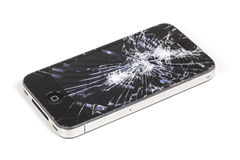 与严重残破的视网膜显示屏的IPhone 4 免版税库存照片