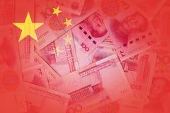 与中国货币的透明中国旗子在背景中 图库摄影