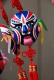 与中国结的中国面具 免版税图库摄影