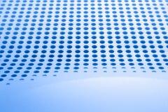 与为创造性、墙纸和背景连续建立的孔的抽象淡色的表面 免版税库存图片