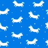 与乐趣独角兽的无缝的在蓝色背景的样式和星 纺织品和包裹的圣诞快乐装饰品 免版税图库摄影