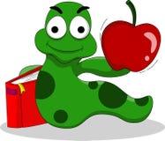 与书和苹果的毛虫 免版税图库摄影