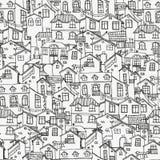 与乱画房子的手拉的背景 免版税库存照片