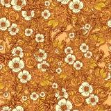 与乱画花的无缝的样式在桔子 库存图片
