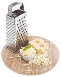 与乳酪磨丝器的Emmentaler在白色 免版税库存照片