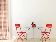 与二把红色椅子的表 免版税库存照片