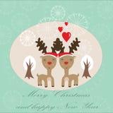 与二驯鹿的逗人喜爱的圣诞卡 库存图片