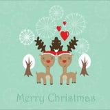 与二驯鹿的逗人喜爱的圣诞卡 免版税库存图片