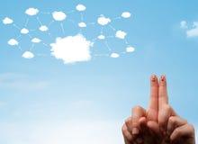 与云彩网络系统的手指面带笑容 免版税库存图片
