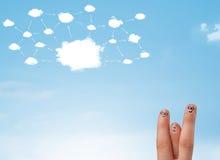 与云彩网络系统的手指面带笑容 免版税图库摄影