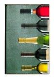 与五个酒瓶的册页 免版税库存图片