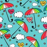 与五颜六色的伞的无缝的样式 免版税库存图片