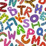 与五颜六色的儿童字母表的无缝的样式 图库摄影