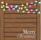 与五颜六色的光的圣诞节背景 Planked木头背景 库存图片