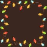 与五颜六色的圣诞灯的框架 免版税库存图片
