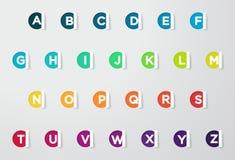 与五颜六色的字母表的圈子纸被删去的笔记 图库摄影