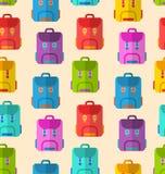 与五颜六色的学校背包的无缝的样式 库存图片