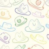 与五颜六色的帽子的无缝的纹理 免版税库存照片