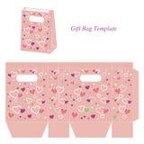 与五颜六色的心脏的桃红色礼物袋子 免版税图库摄影
