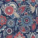 与五颜六色的民间东方主题或mehndi元素的花卉佩兹利无缝的样式在蓝色背景 五颜六色 免版税库存照片